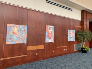 Paintings by Holly Troy: Rebirth of Icarus, Trapeze, Buddha Beach at HCCC